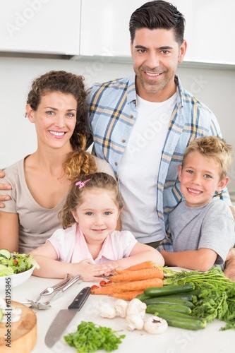 Smiling family preparing vegetables together
