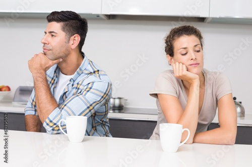 Unhappy couple having coffee not talking