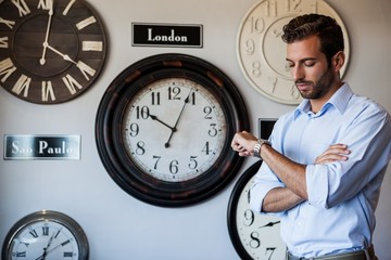 Handsome businessman checking the time