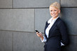 Confident businesswoman using smart phone