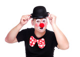 Birthday clown holding his bowler hat