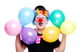 Happy clown holding colorful balloons