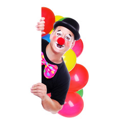 Happy clown with balloons holding the blank board