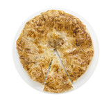 Burek, filo pastry in white plate with cutting pieces , isolated