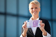 Attractive businesswoman holding 500 euro