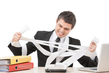 young businessman tearing paper apart.