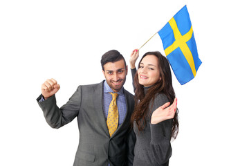 Couple cheering Sweden waving flag