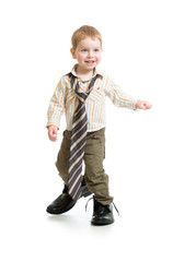 Adorable boy in big father's shoes isolated on white