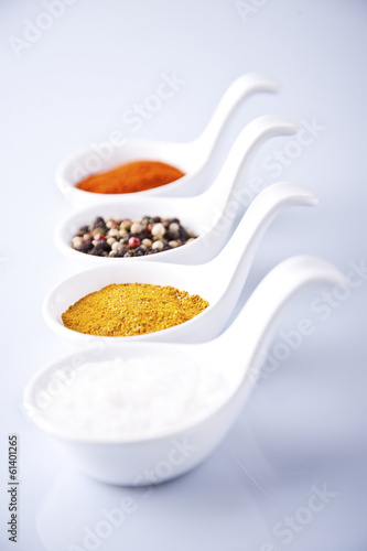 Various spices and herbs on white background