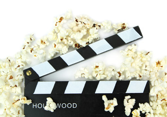 Popcorn and movie clapper , close up image