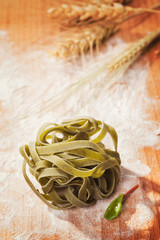 Fresh tagliatelle on a wooden table