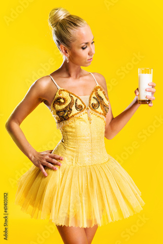 Ballerina with glass of milk