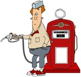 Boy pumping gas from a retro pump