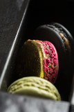 Green, black and gold french macaron