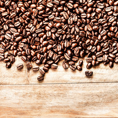 Roasted Coffee Beans background texture on wooden background fra