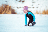 cute little girl on the ice in