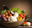 still life with vegetables isolated on brown background