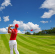 Man playing golf against blue sky