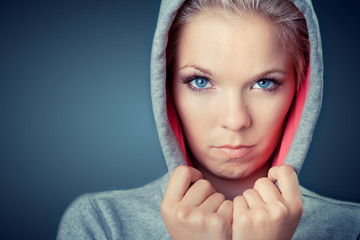 angry and displeased woman wearing hood