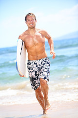 Surfer beach lifestyle people - man surfing