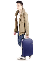 Man carrying a luggage and going in vacation, tourist