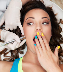 Woman in medical spa center, hesitation, pain concept