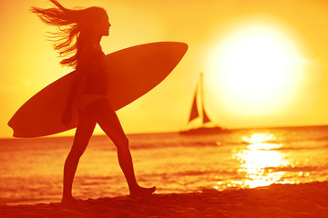 Surfing surfer woman babe beach fun at sunset