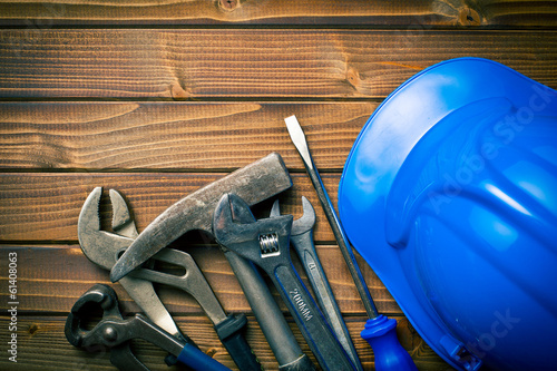 hard hat with various working tools