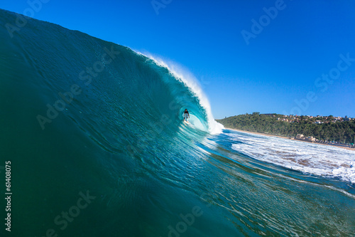Surfer Surfing Inside Hollow Crashing Blue Wave