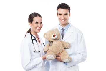 Pediatric doctors holding teddy bear