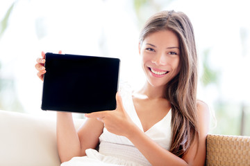 Tablet computer showing by woman sitting smiling