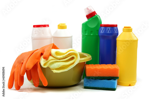 Detergent bottles, rubber gloves and cleaning sponge.