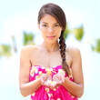 Spa wellness pretty woman portrait, flower in hand