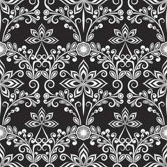 Seamless black and white floral wallpaper pattern.