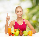 woman with juice and fruits holding finger up