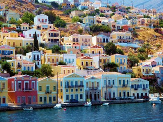 beautiful colorful houses on hill, Symi island, Greece