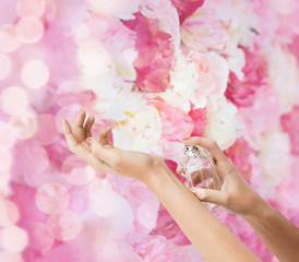 woman hands spraying perfume