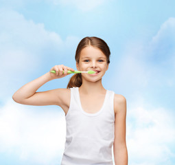 girl in blank white shirt brushing her teeth