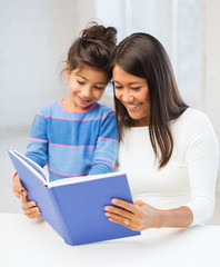 mother and daughter with book