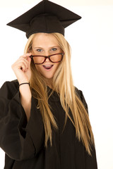 female model in graduate attire close up peering over glasses