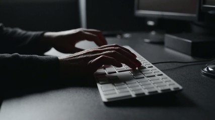 Female hands typing computer keyboard.