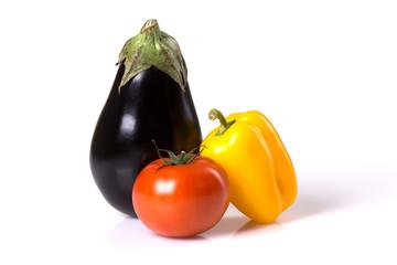 Fresh eggplant, tomato, paprika isolated on a white background.