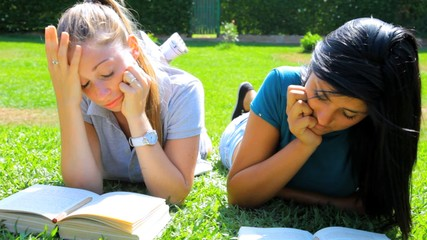 Female students in college reading books