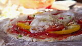 Tasty cheese falling on pizza, super slow motion, shot at 240fps