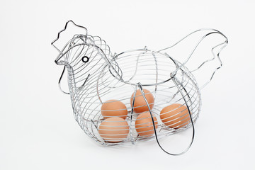 Metallic basket of eggs shaped hen