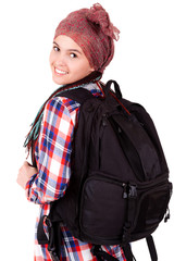 young girl with backpack ready to travel, white background
