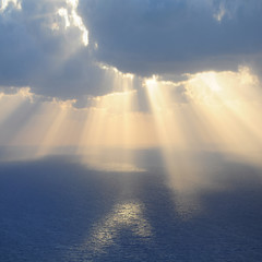 Clouds and rays of sun above the sea.