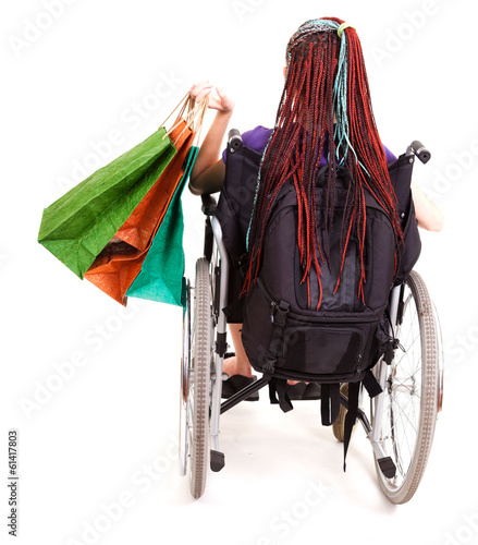 Shopping woman on wheelchair, white background