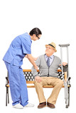 Male healthcare professional assisting a senior gentleman