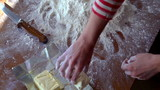 Baker throwing butter on white flour, super slow motion, 240fps